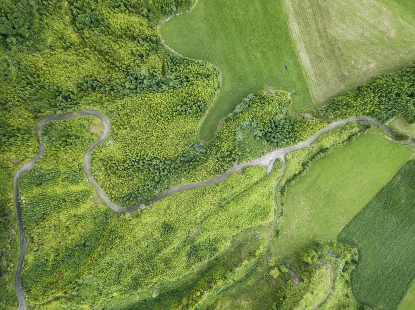 This image has an empty alt attribute; its file name is bigstock-aerial-view-of-a-rural-road-ne-273179800.jpg
