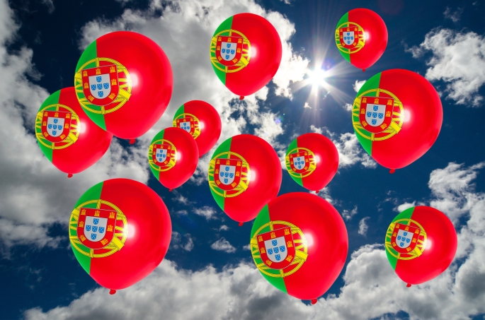 Many Balloons With Portugal Flag On Sky