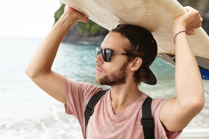 Surfer Lifestyle During Summer Travel Vacation. Close Up Portrai
