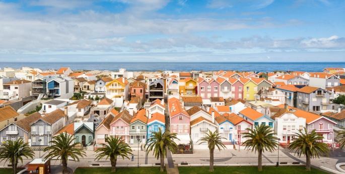"""Aerial shot of the """"palheiros"""" in Costa Nova, Aveiro, Portugal"""